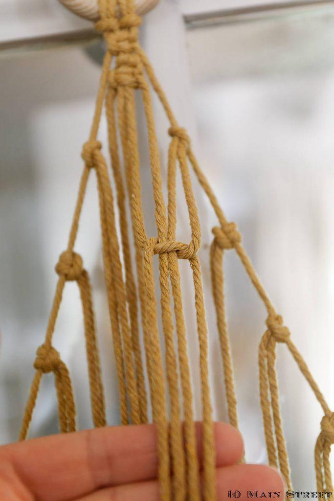 Nœud plat avec 2 cordes latérales et 2 cordes centrales