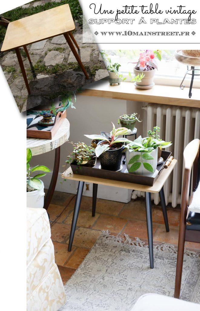 Une petite table vintage très usée rénovée comme support à plantes
